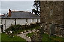 SW4538 : Zennor: gravestones and base of tower, St Senara's church by Christopher Hilton