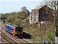 SK5124 : An East Midlands train passing the former brick and terracotta works by Ian Calderwood