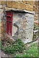 SP4341 : Old milestone and post box at Crickle Cottage by Roger Templeman