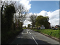TM1553 : Entering Hemingstone on Main Road by Adrian Cable