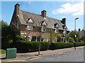 TQ3290 : Housing terrace, Waltheof Avenue by Julian Osley