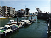 SY6778 : Yacht passing through Town Bridge, Weymouth by pam fray