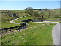 SD9532 : Bridges over Alcomden Water at Holme End, Wadsworth by Humphrey Bolton