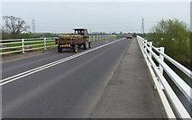 SK8174 : Tractor crossing the Dunham Toll Bridge by Mat Fascione