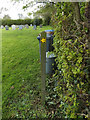 TM1852 : Footpath Marker in St.Mary's Churchyard by Adrian Cable