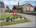 TG5011 : Elizabeth II postbox on West Road, West Caister by JThomas