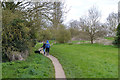 SP3779 : Couple with a dog on the Sowe Valley footpath, Binley, Coventry by Robin Stott