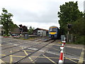 TL9963 : Train approaching Elmswell Level Crossing by Adrian Cable