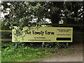 TM1152 : Baylham House Farm sign by Adrian Cable