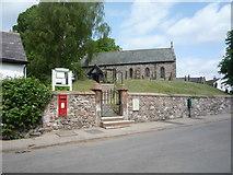 NY3459 : Elizabeth II postbox, St Mary's Church, Beaumont by JThomas