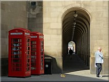 SJ8397 : Phone boxes and covered walkway by Neil Theasby