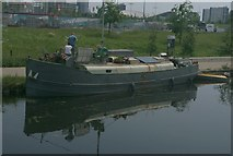 TQ3784 : View of a boat reflected in the River Lea from the River Lea Navigation #3 by Robert Lamb