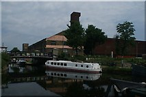 TQ3784 : View of a boat reflected in the River Lea from the River Lea Navigation #4 by Robert Lamb