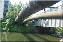 TQ3783 : View of the Northern Outfall Sewer pipes crossing the River Lea from the River Lea towpath by Robert Lamb