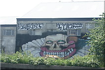 TQ3783 : View of Sweet Tooth street art on the rear of a warehouse on the River Lea by Robert Lamb