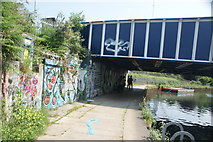 TQ3783 : View of street art under the old railway bridge from the River Lea towpath by Robert Lamb