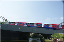 TQ3783 : View of a DLR train crossing the River Lea from the River Lea towpath by Robert Lamb