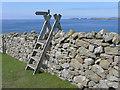 HU1656 : Coastal path sign and stile by Julian Paren