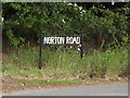 TL9563 : Norton Road sign by Adrian Cable