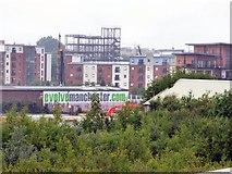 SJ8297 : Evolving Manchester by Gerald England