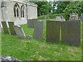 TF0436 : Slate gravestones in St Botolph's Churchyard, Newton by Marathon