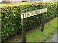 TL9578 : Thetford Road sign by Adrian Cable