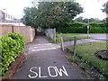 SZ0796 : Kinson: footpath E49 crosses the Conservative Club car park by Chris Downer