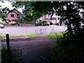 SZ0696 : Kinson: footpath E24 emerges onto Wimborne Road by Chris Downer
