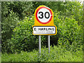 TL9886 : East Harling Village Name sign on the B1111 Church Road by Adrian Cable