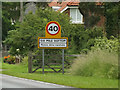 TL5756 : Six Mile Bottom Village Name sign on the A1304 London Road by Adrian Cable