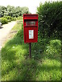 TL9682 : Home Farm Postbox by Adrian Cable
