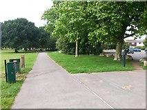 SZ0794 : Ensbury Park: Slades Lane passes Slades Farm car park by Chris Downer