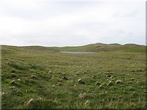 HU3175 : Stubba Water, and its surrounding low hills by David Purchase