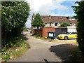 SZ0596 : Bear Cross: footpath E01 reaches the shops' rear driveway by Chris Downer