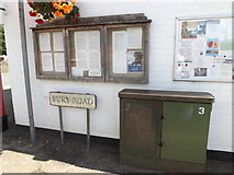 TL9979 : Bury Road sign & Telecommunications Box by Adrian Cable
