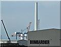 J3677 : Wind turbine masts, Belfast harbour (June 2016) by Albert Bridge