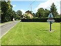 TL8984 : Brettenham Road & Kilverstone Village sign by Adrian Cable