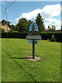TL8984 : Kilverstone Village sign by Adrian Cable