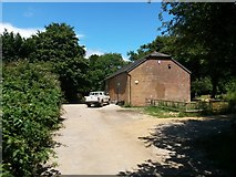 SZ0995 : Muscliff: footpath M15 passes Kingfisher Barn by Chris Downer