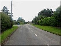 NZ1883 : Minor road, Tranwell by Graham Robson