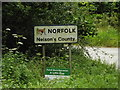 TM0080 : Norfolk County Name sign on the B1111 Common Road by Adrian Cable