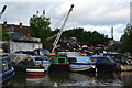 SP3687 : Jumble of boats and rubbish beside the Coventry Canal at Bedworth by David Martin