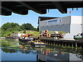 TQ2182 : Old Oak Wharf, canal in use for construction materials by David Hawgood