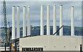 J3677 : Wind turbine masts, Belfast harbour - July 2016(5) by Albert Bridge
