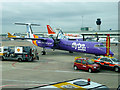 SJ8284 : Flybe at Manchester Airport by David Dixon