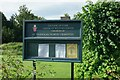 SE8467 : St Nicholas' Church: The nameboard by the road by Bob Harvey