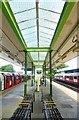 TQ4591 : Platforms, Hainault Underground Station by Julian Osley