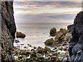 NW9954 : Irish Sea Through the Rocks by David Dixon
