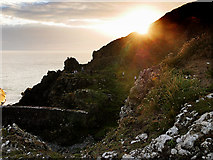 NW9954 : Sunset, Portpatrick Cliffs by David Dixon