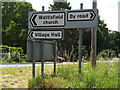 TM0074 : Roadsigns on the A143 Bury Road by Adrian Cable